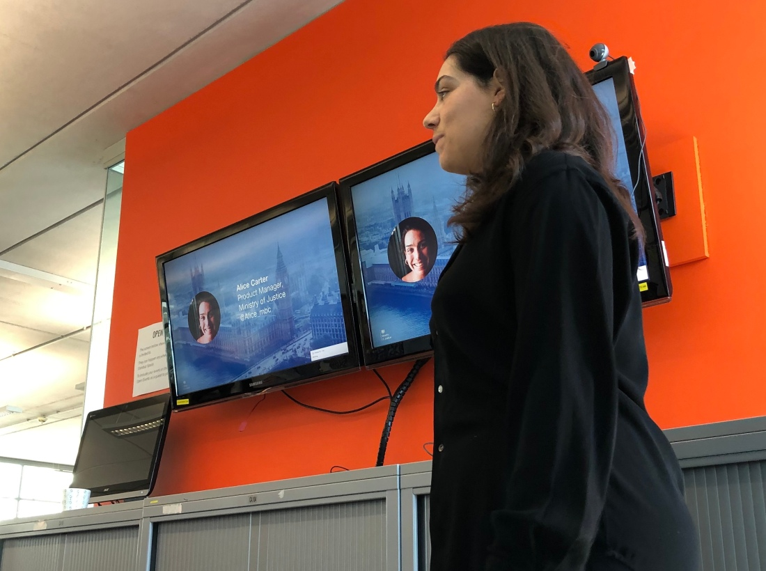 Alice Carter presenting in front of a screen